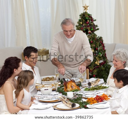 Family having Christmas dinner eating turkey at home - stock photo