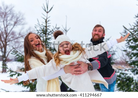 Family Having Fun Flying Daughter on the snow - stock photo