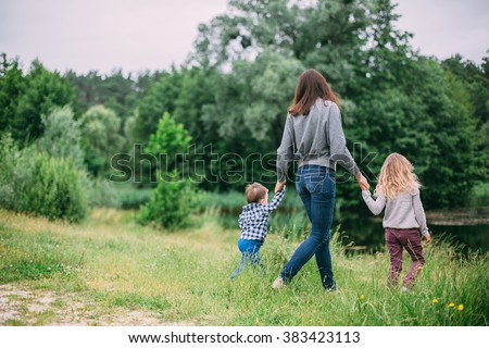 family having fun outdoors in the green park - stock photo