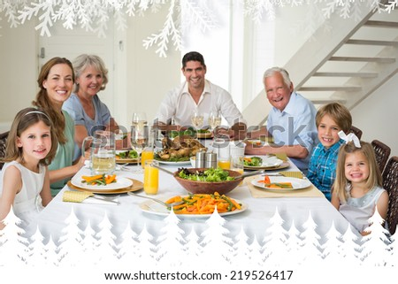 Family having meal together at dining table against fir tree forest and snowflakes - stock photo