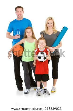 Family: Healthy Family All Holding Favorite Workout Equipment - stock photo