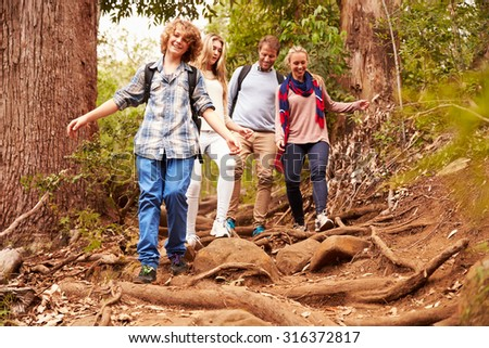 Family hiking through a forest - stock photo