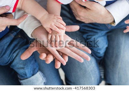 Family holding hands together closeup. Happy family - stock photo