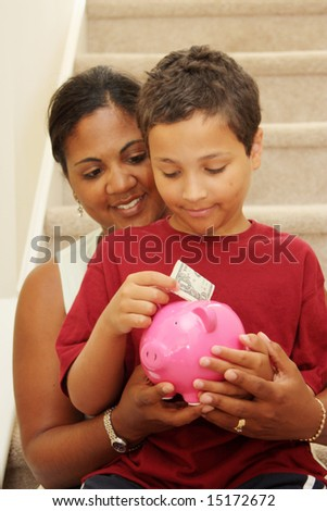 Family Holding Piggy Bank With Their Savings - stock photo