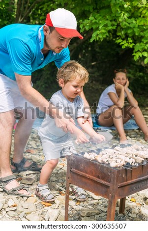 Family holidays in nature with shish kebab - stock photo