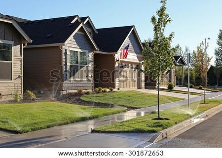 Family homes in suburban neighborhood - stock photo