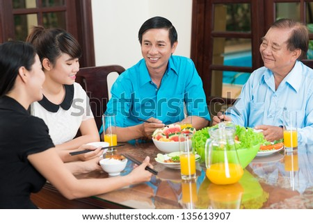 Family image discussing the latest news at the dinner - stock photo