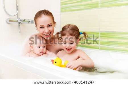 family in a bath with foam mother together children baby - stock photo