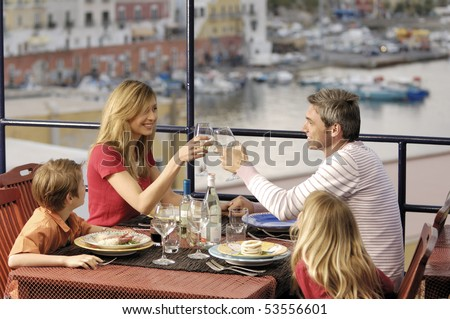 family in a sea restaurant - stock photo