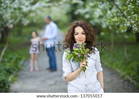 Family in a spring garden - stock photo