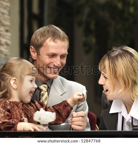 family in cafe - stock photo