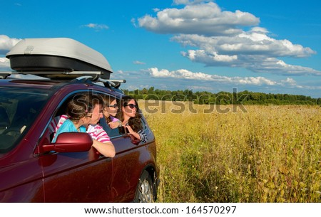 Family in car on vacation, happy parents and kids travel and have fun, car insurance concept  - stock photo
