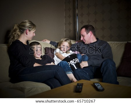 Family in front of Television in a sofa - stock photo
