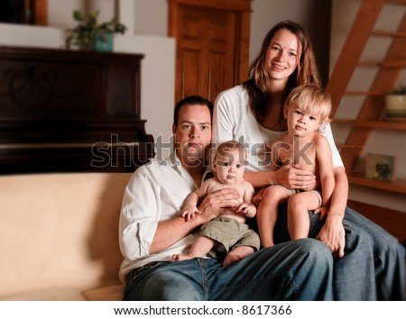 Family in living room - stock photo