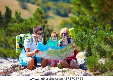 family in mountains discussing the route - stock photo