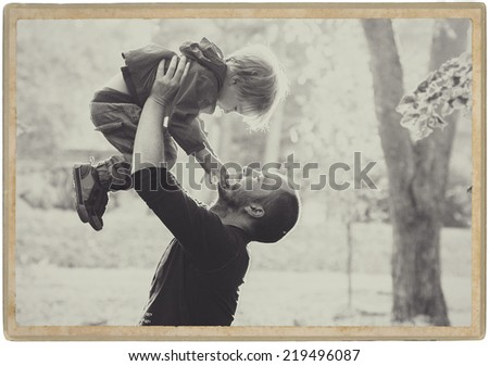 family in park, black and white father with son - stock photo
