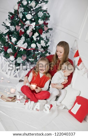 Family in red Christmas at home - stock photo