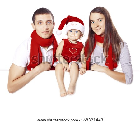 Family in the costumes of Santa Claus posing on a blank on the banner - stock photo