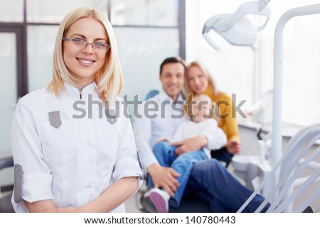 Family in the dentist's office - stock photo