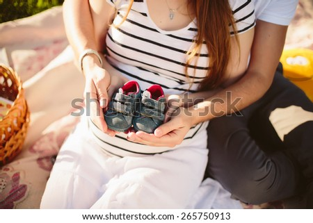 Family in the park pregnancy - stock photo