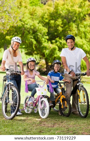 Family in the park with their bikes - stock photo
