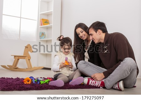 Family in the room - stock photo