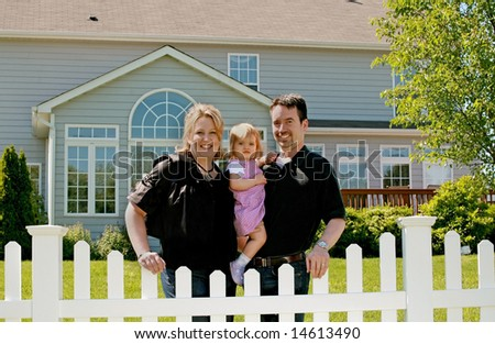 Family in Their Backyard of Home - stock photo