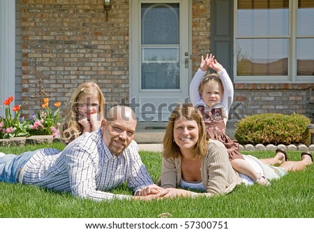 Family in Their Front Yard - stock photo