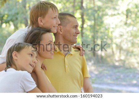 Family is resting in a summer park - stock photo