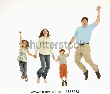 Family jumping and smiling while holding hands. - stock photo