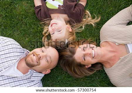 Family Laying Down Smiling - stock photo