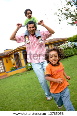 family lifestyle portrait of a dad with his sons having fun outdoors - stock photo
