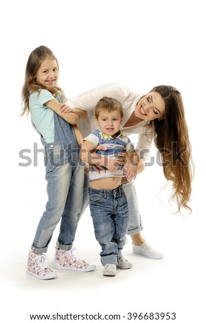 Family, little three year boy made laugh a young mother and his six-year old sister, they have fun are laughing, white background. - stock photo
