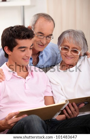 Family looking at a photo album - stock photo