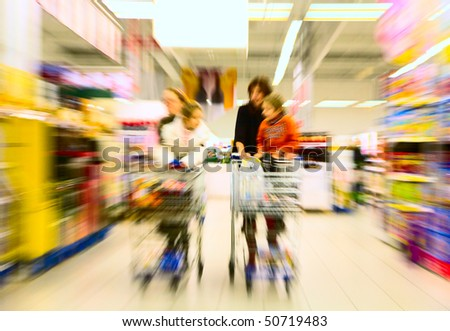 Family makes a purchase at the supermarket - stock photo