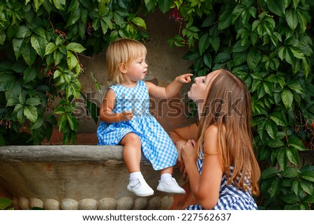 Family, mother and daughter look at each other and smile - stock photo