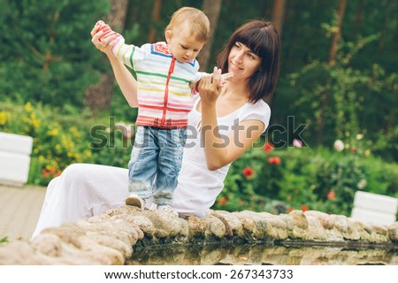 Family mother with child happy outdoors summer time - stock photo