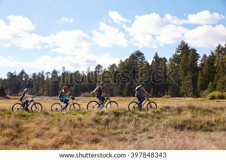 Family mountain biking in countryside, California - stock photo