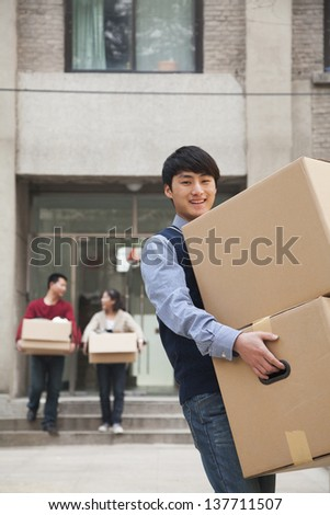 Family moving boxes out of a dormitory at college - stock photo