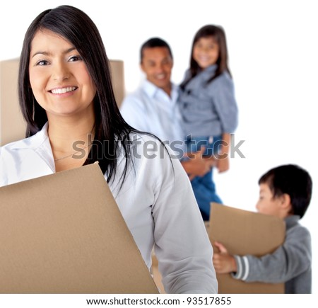 Family moving house carrying boxes - isolated over a white background - stock photo