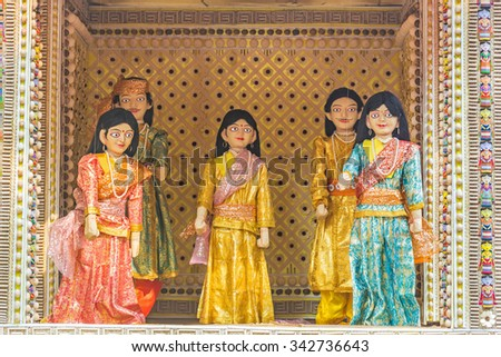Family of beautiful puppets in a puppet show operated using strings. - stock photo