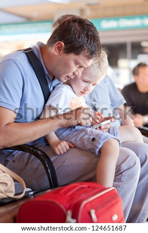 family of father and his son waiting at the airport - stock photo