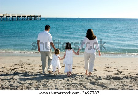 Family of Four at Beach - stock photo