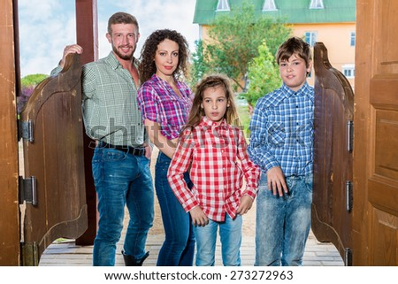 family of four ging to enter wild west saloon - stock photo