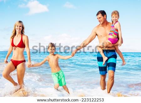 Family of Four Having Fun on Tropical Beach in Hawaii - stock photo