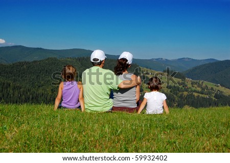 Family of four looking at the beautiful view - stock photo
