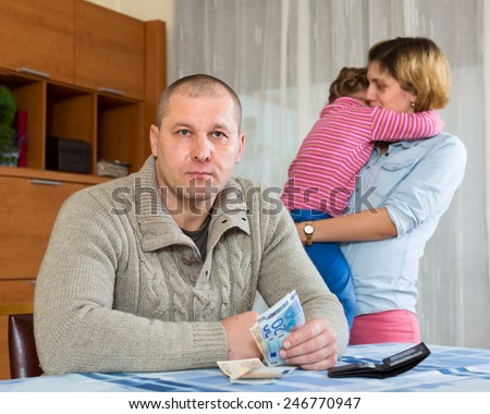 Family of four with children  having  financial problems  - stock photo