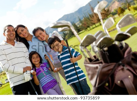 Family of golf players at the course in a beautiful day - stock photo
