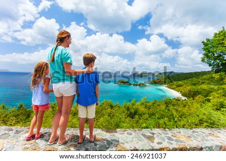 Family of mother and kids enjoying aerial view of picturesque Trunk bay on St John island, US Virgin Islands considered by many as most beautiful beach in Caribbean - stock photo