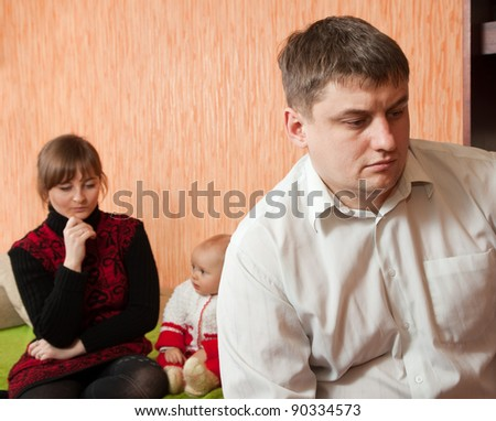 Family of three having quarrel at home - stock photo